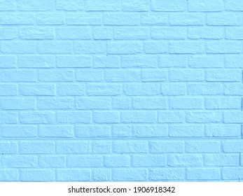 The light blue brick wall