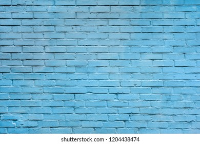Light blue brick wall background. Texture of a brick wall. Modern wallpaper design for web or graphic art projects. Abstract background for business cards and covers. Template or mock up.