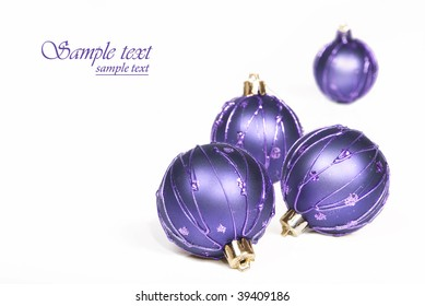 Light blue christmas baubles with a white background with space for text