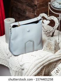 light blue crossbody bag with with golden details
