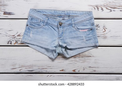 ced1a1139d Light blue denim shorts. Short shorts on wooden background. New item from  jeans store