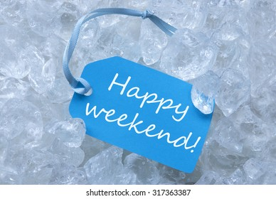 Light Blue Label With Blue Ribbon On White Transparent Curshed Ice Cubes As Background. English Text Happy Weekend For Cool Greetings.Close Up Or Macro View.