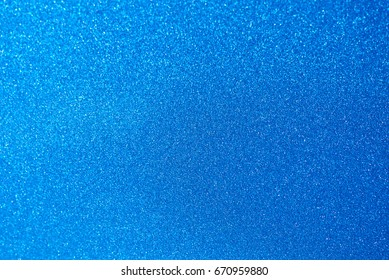 Light blue metal car paint surface. Metal matte blue wallpaper background