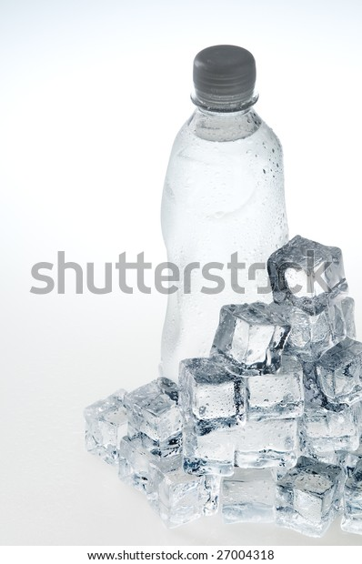 Light blue mineral water bottle and ice cubes