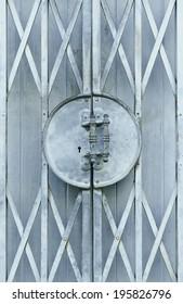 Light blue old metal grille sliding door