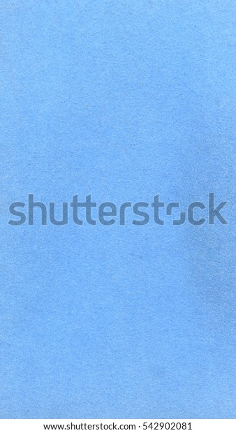 Light blue paper texture useful as a background - vertical