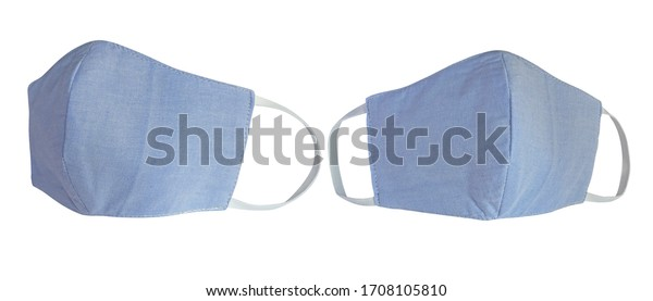 Light blue pastel cotton cloth face masks isolated on white with clipping path. Due to lack of medical protective masks during Coronavirus (COVID-19) pandemic, regular people instead wear cotton masks