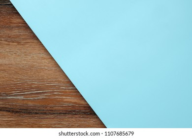 Light blue pastel paper color on wooden table for background