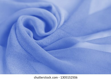 Light blue silk textile industry and fabric background