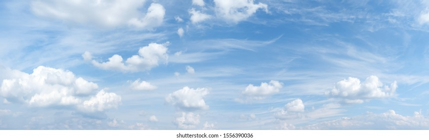 Light blue sky with beautiful romantic cloudscape - panorama