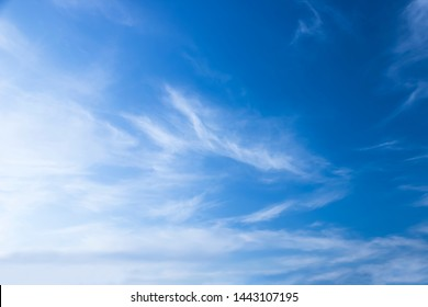 Light blue sky with some white clouds.