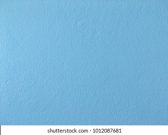 Light blue smooth concrete wall background