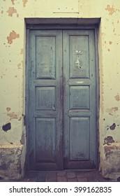 Light blue vintage door weathered.