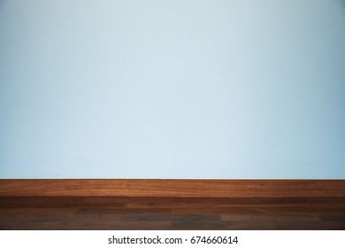light blue wall with wood floor