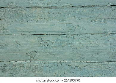 light blue wooden planks with peeling old paint, texture