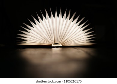 Light up book in dark room