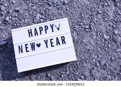 Light box.White label, There is a letter written that Happy New Year .Put on Crushed Gravel.  concept:New Year's Day festival.Used as a background image