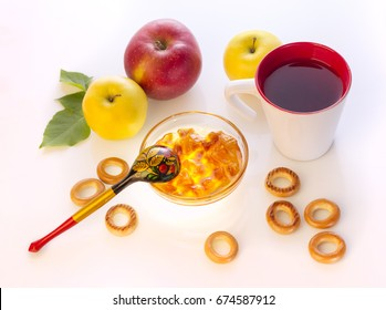 light breakfast with apples, bagels, tea and homemade jam, isolated on white