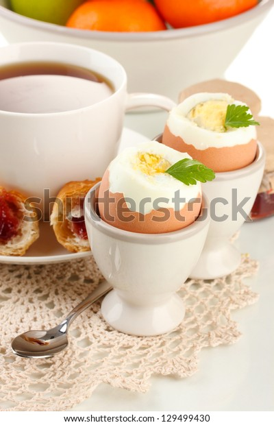 Light breakfast with boiled eggs and coffee, close up