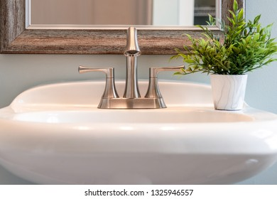Light and bright closeup of bathroom sink with brushed nickel faucet home, decor, room, interior design, detail, style, clean, modern, minimal, copy space