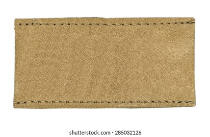 light brown blank leather jeans label on white