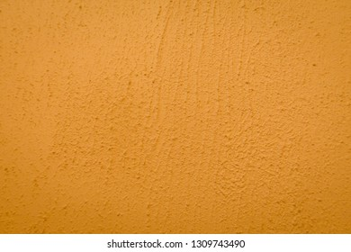 Light brown cement wall texture blackground