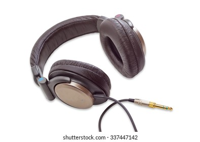 Light brown full size headphones with soft headband and yellow phone audio connector on a light background. Isolation.
