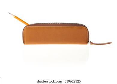 A light brown leather pencil case side view isolated white.