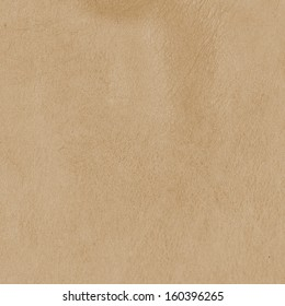 light brown leather texture . Useful as background for design-works.