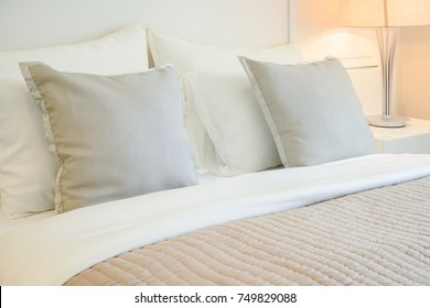 Light brown pillows on comfortable bed in modern bedroom interior