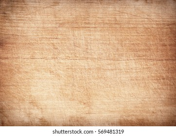 Light brown scratched wooden cutting board. Wood texture