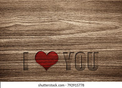 Light brown wood grain texture with a special craving I LOVE YOU message with a red heart for the love one.