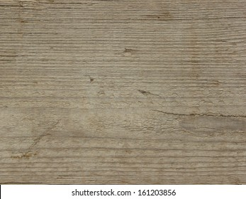 Light brown wood texture with many small cracks in the horizontal grain.