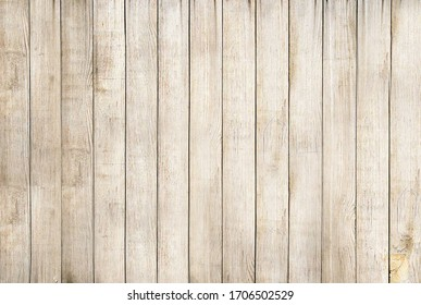 A light brown wooden Board is laid out vertically .Texture or background
