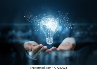 Light bulb with brain inside the hands of the businessman. The concept of the business idea.
