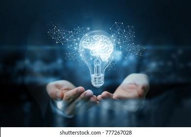 Gloeilamp met hersenen in de handen van de zakenman. Het concept van het bedrijfsidee.