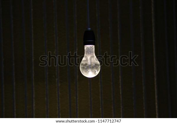 light bulb dust dark room