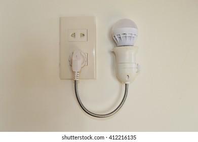 Light bulb in electricity plug