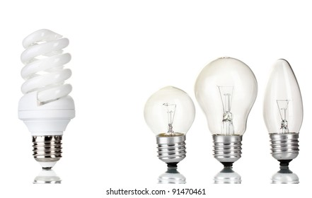 Light bulb and  energy saving lamp isolated on white