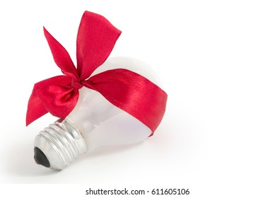 Light bulb gift with red ribbon