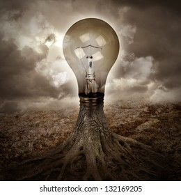 A light bulb is growing as a tree in a dark nature scene with roots for an energy or idea concept.