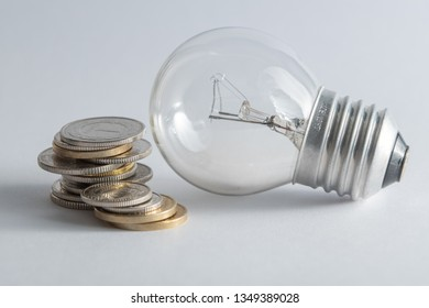 Light bulb with heap of coins stairs for financial plan or business idea concept - Imagen
