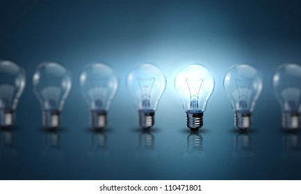 Light bulb lamps on a colour background
