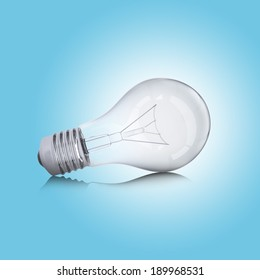 Light bulb lies on the reflecting surface