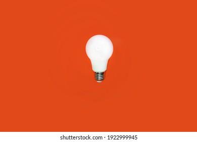 light bulb on an orange background. idea