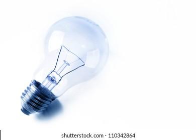 Light bulb on plain background
