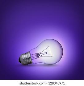 light bulb on purple background on the ground