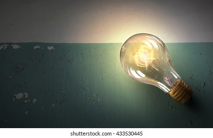Light bulb on stone surface