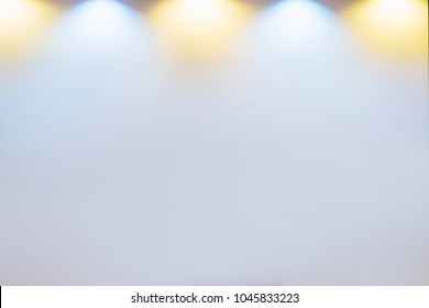 Light from a light bulb on a white projector background.