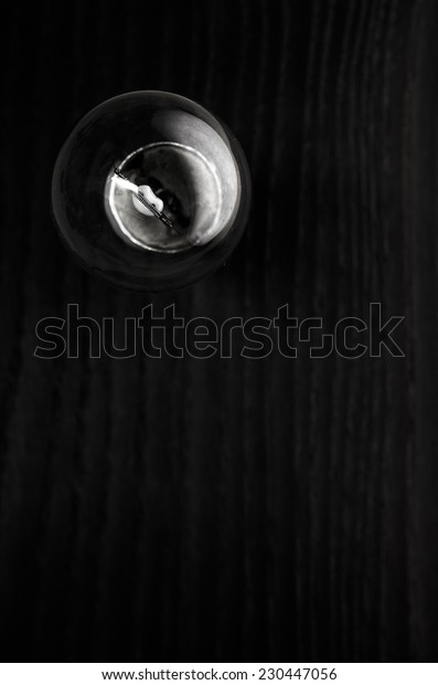 light bulb on a wood surface